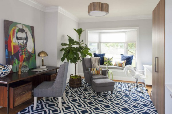 A gorgeous mid-century style desk and inspiring art canvas were the jumping off points for the high-low mix in a fun and functional family study space. </br>(Arlington, Virginia)
