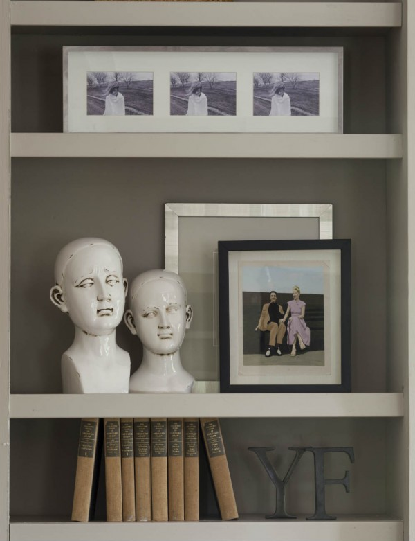 A client's unique artwork is layered in the library bookcase. </br>(Arlington, Virginia)