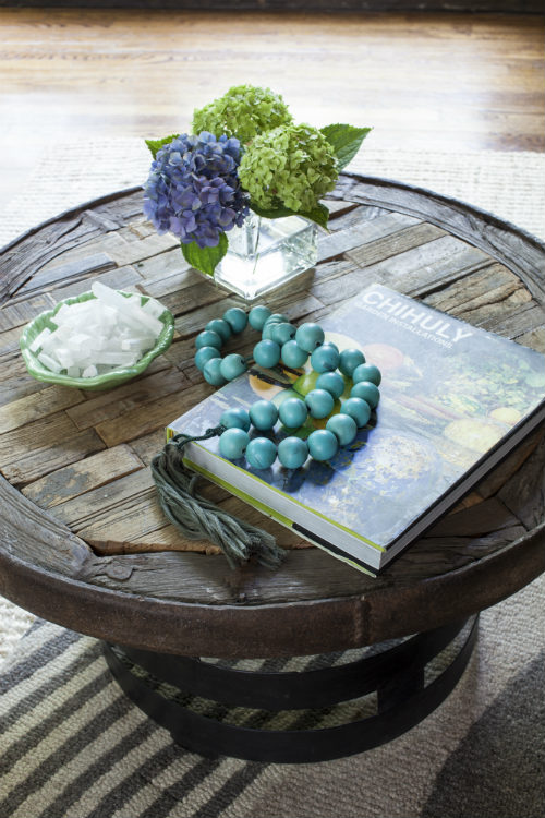 An Arlington homeowner's bohemian nature shines through creative cocktail table styling. </br>(Arlington, Virginia)