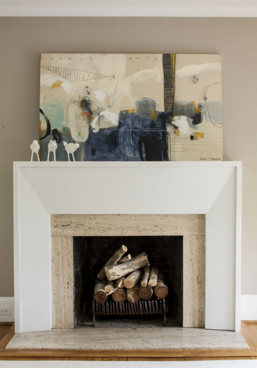 Stunning original artwork puts the exclamation point on the architectural statement made by this mixed material fireplace. </br> (Arlington, Virginia)
