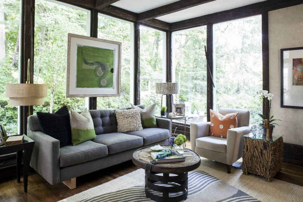 A dramatic outdoor view sets the stage for an interior filled with floor to ceiling texture. A twiggy side table mimics the woods beyond the glass. </br>(Arlington, Virginia)
