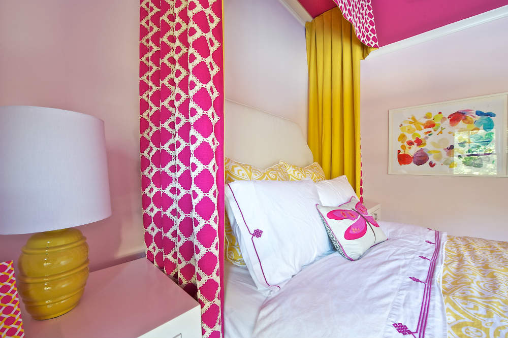 A custom cornice and colorful drapery make this little girl's room fit for a cheerful princess at any age. </br>(McLean, Virginia)